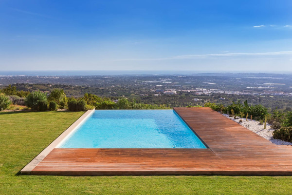Outdoor custom pool with view and decking