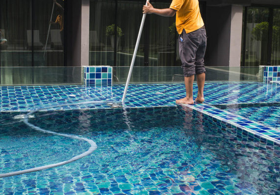 Pool cleaning scrubbing tiles