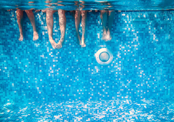 Tiled pool underwater children swimming playing
